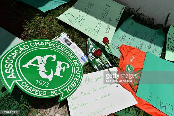 People pay tribute to the players of Brazilian team Chapecoense Real who were killed in a plane accident in the Colombian mountains at the club's...