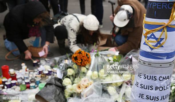 People pay tribute to victims of the kosher supermarket in front of HyperCacher supermarket at Porte de Vincennes in eastern Paris France on January...