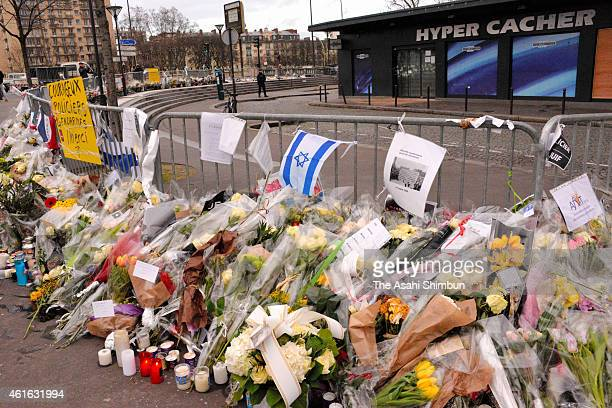 People pay tribute to victims of the kosher supermarket in front of HyperCacher supermarket at Porte de Vincennes on January 16 2015 in Paris France