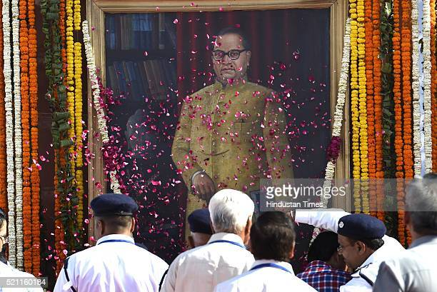 People pay tributes during the floral tribute ceremony of Dr BR Ambedkar on his 125th birth anniversary at Parliament House on April 14 2016 in New...
