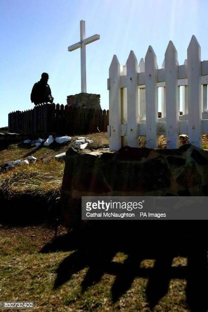 People paying their respects at a memorial at Fitzroy Falkland Islands for members of the British Army killed during the Falklands War