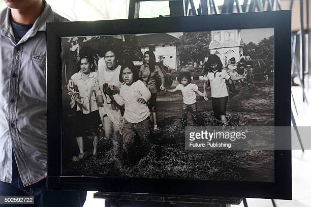 People pays a visit at a photo exhibition on Tsunami 2004 by a photojournalist during the 11th anniversary of the 2004 Indian Ocean Tsunami also...