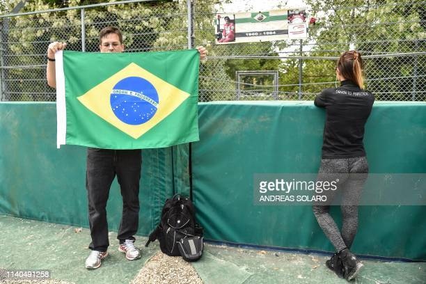 """People pays her respect on May 1, 2019 on the """"Tamburello"""" track curve of the Imola """"Enzo and Dino Ferrari"""" circuit where Brazilian's F1 driver..."""