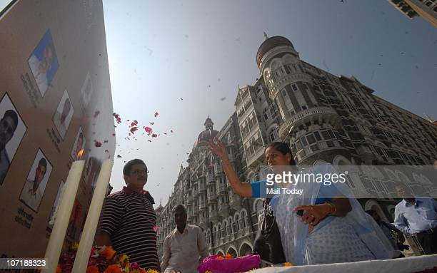People pays homage to those who died in the November 2008 terror attacks at a memorial outside the Taj Mahal Palace hotel on the second anniversary...