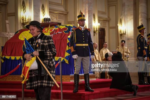 People pays their respects in front of the coffin of King Michael I of Romania on December 13 2017 at the former Royal Palace that houses the...