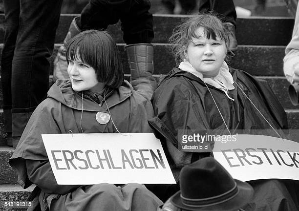 people peace demonstration Easter marches 1983 in Germany against nuclear armament two young women presenting a protest sign aged 20 to 30 years face...