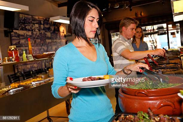 People People in the restaurant typical Feijoada