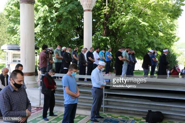 People perform a congregational prayer at a mosque after re-opening of mosques in Skopje, North Macedonia on May 12, 2020. After a two months break...