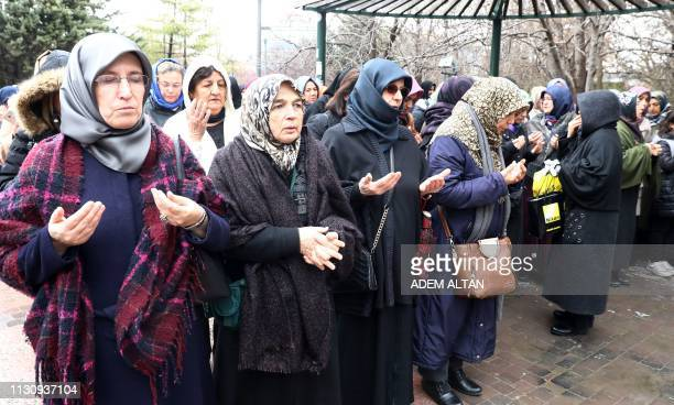 People perform a funeral prayer in absentia for those who lost their lives during twin terror attacks in New Zealand mosques on March 16 2019 in...
