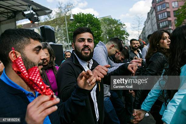 People perform a traditional Kurdish dance at the annual MyFest in Kreuzberg district on May 1 2015 in Berlin Germany May Day or International...