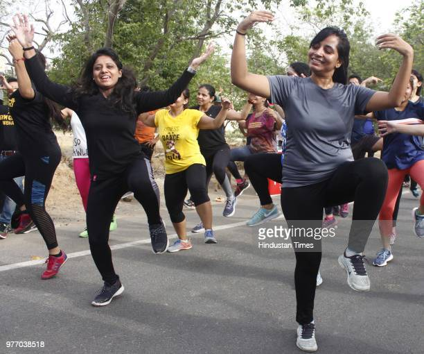 People perform bhangra and zumba during Raahgiri Day at Sector 55 Golf Course Road an event organised by MCG on June 17 2018 in Gurugram India...