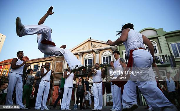 People perform capoeira a Brazlian martial art mixing dance and music at the Rock in Rio festival on September 18 2015 in Rio de Janeiro Brazil The...