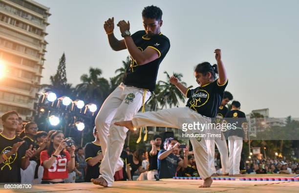 People perform Capoeira during Batizado event at Carter Road on May 7 2017 in Mumbai India Capoeira is a Brazilian martial art that combines elements...