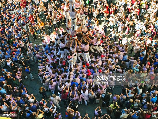 People perform Catalan traditional human tower in Girona Spain on October 29 2017 Catalonian Parliament declared the unilateral independence during a...