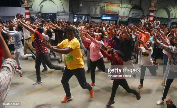 People perform dance steps during a flash mob at CSMT on the eve of Gandhi Jayanti, around 70 staff from railways participated, on October 1, 2018 in...