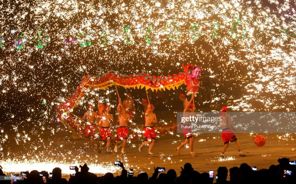 People perform dragon dance in the splash of molten iron to celebrate the Spring Festival in a traditional way in Yongcheng in central China's Henan province Tuesday Feb. 20, 2018.PHOTOGRAPH BY Feature China / Barcroft Images