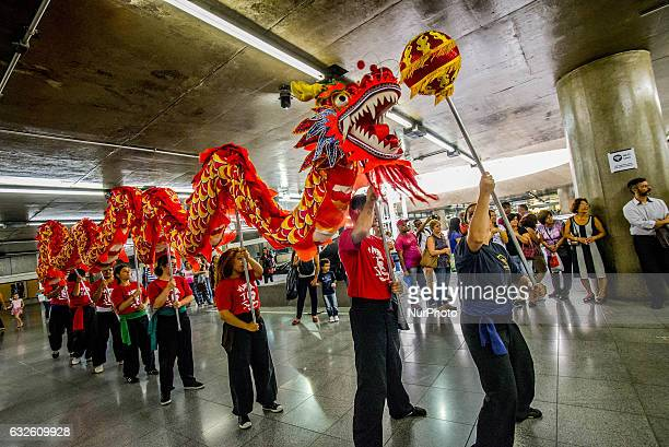 People perform dragon dance to announce Chinese Lunar New Year celebrations at Metro's Sé Station in Sao Paulo Brazil on January 24 2017 The Chinese...