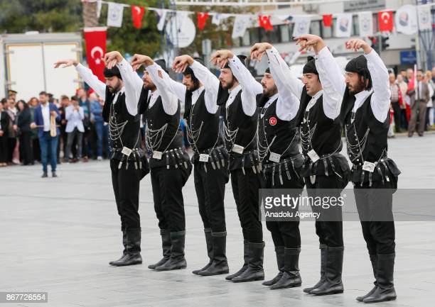 People perform during the celebrations for the 94th Anniversary of Republic Day at the Izmir Cumhuriyet Square in Izmir Turkey on October 29 2017