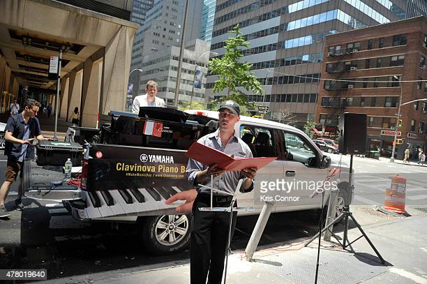 People perform during the Clavinova Piano Bar at PJ Clark's during Make Music Day 2015 on June 21 2015 in New York City