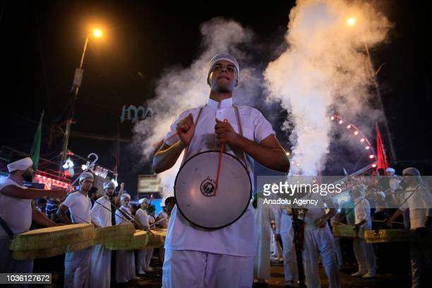 People perform during the holy month of Muharram commemorations in Baghdad Iraq on September 19 2018 Ashure or Noah's Pudding dessert porridge made...