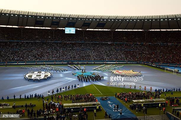 People perform during the opening ceremony of the UEFA Champions League Final football match between Juventus and FC Barcelona at the Olympic Stadium...