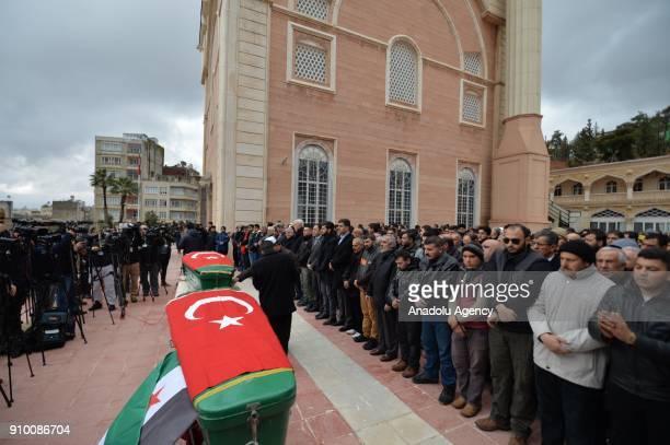 People perform funeral prayer of Muzaffer Aydemir and Tarik Tabbak who lost their lives after members of PKK/PYD terrorist organization in Afrin...