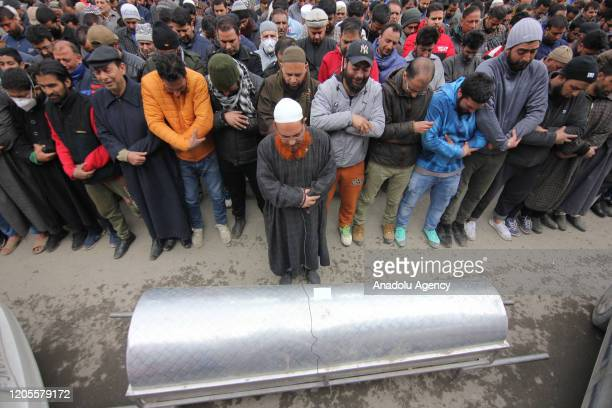 People perform funeral prayers for the family members who were charred to death in a house blaze in Srinagar Kashmir India on March 07 2020 A couple...