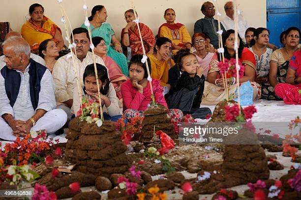 People perform Govardhan Puja also called Annakut at Gaushala on November 12 2015 in Noida India Govardhan Puja is celebrated with the worshipping of...