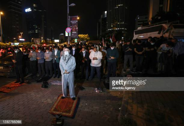 People perform prayer as they gather to protest against Israel's attack on Masjid al-Aqsa at Damascus gate of the Old City and Sheikh Jarrah district...