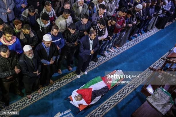 People perform prayer during the funeral ceremony of Muhammed Nebii Muhaysin who was martyred during the clashes between Palestinian protesters and...