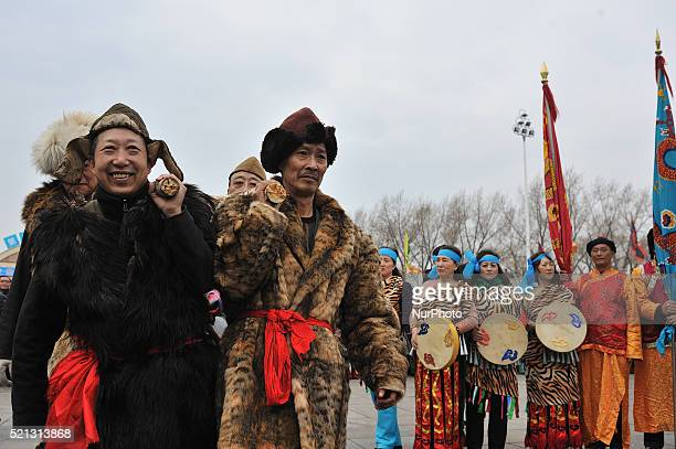 People perform Shaman Dance to pray at the opening of the Kaijiang Festival in Harbin city of China on 15 April 2016 which marks the beginning of the...