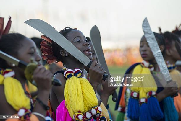 People perform shows during a traditional ceremony Umhlanga Festival at Ludzidzini Royal Village in Lobamba Swaziland on August 28 2016 Umhlanga also...