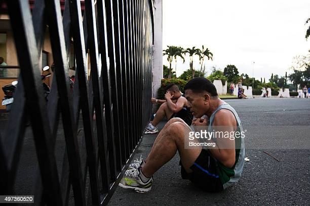 People perform situps while exercising in the morning at Heritage Memorial Park in Taguig City Manila the Philippines on Monday Nov 16 2015 Economic...