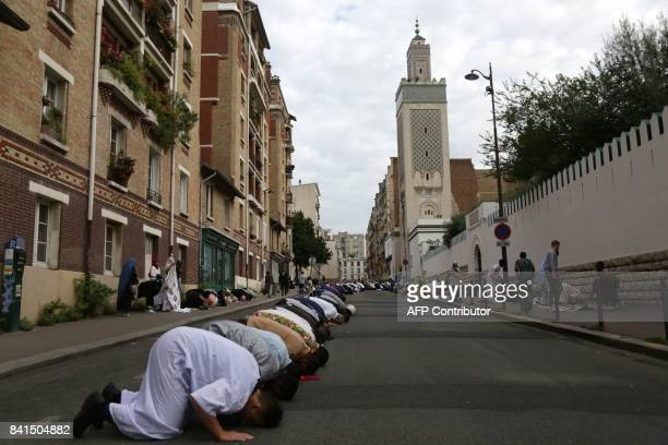 People perform the Friday prayers at the Grand Mosque of Paris on September 1 2017 as Muslims across the world prepare to celebrate Eid alAdha...