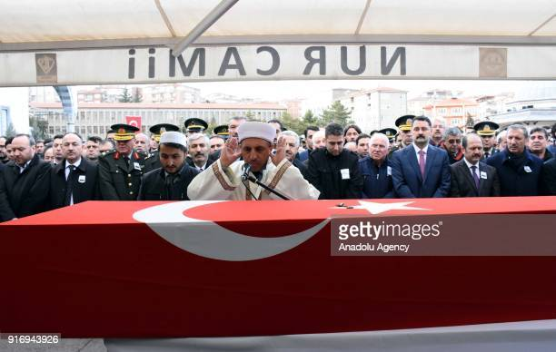 People perform the funeral prayer during the funeral ceremony of First Lieutenant Erdem Mut who was martyred in a helicopter accident within the...