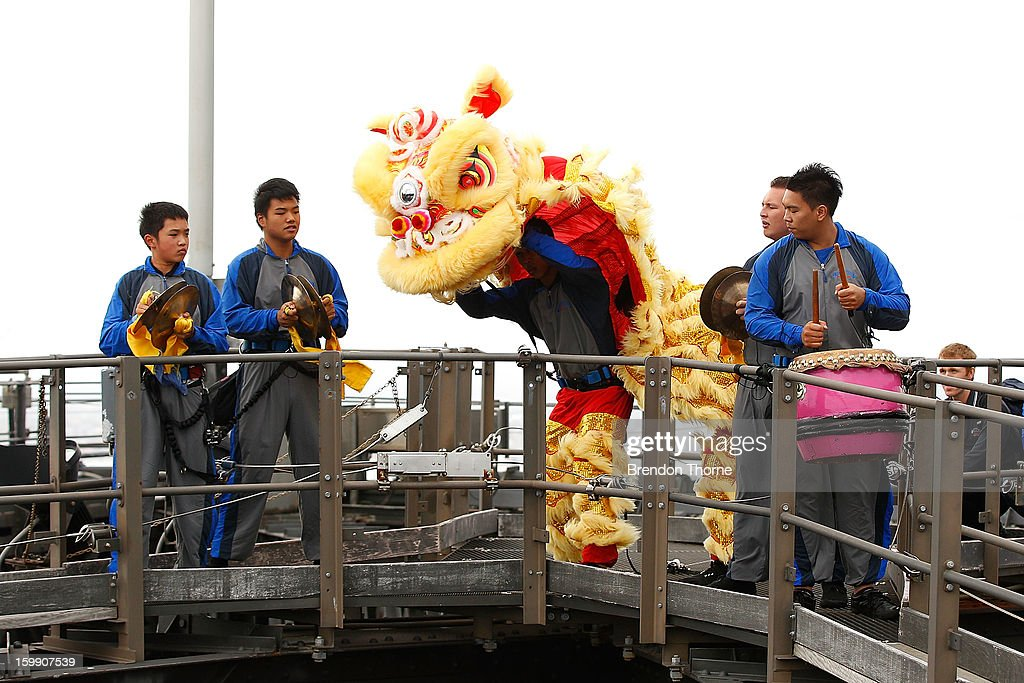 People perform the traditional Chinese Lion Dance atop of Sydney Harbour Bridge on January 23, 2013 in Sydney, Australia. This performance, leading up to Chinese New Year, marks the launch of BridgeClimb's new Mandarin Climb with Mandarin speaking guides.