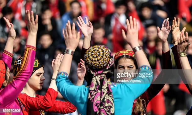 People perform traditional dance during the Newroz celebrations at Topkapi Culture Park in Istanbul Turkey on March 21 2017 Newroz is the March 21...
