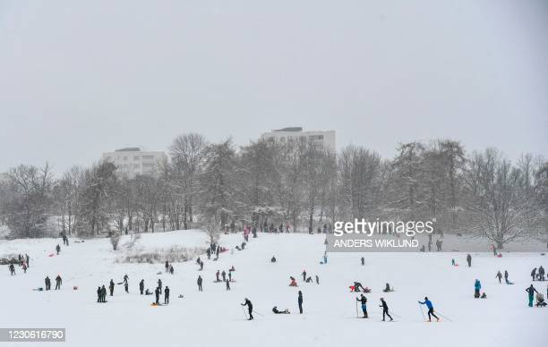 People perform winter activities at Gardet sports field in central Stockholm, Sweden on January 16, 2021. / Sweden OUT