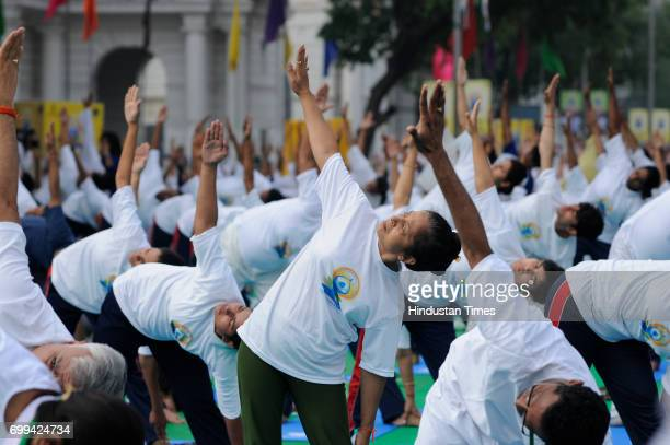 People perform Yoga to mark the International Day of Yoga, on June 21, 2017 in New Delhi, India.