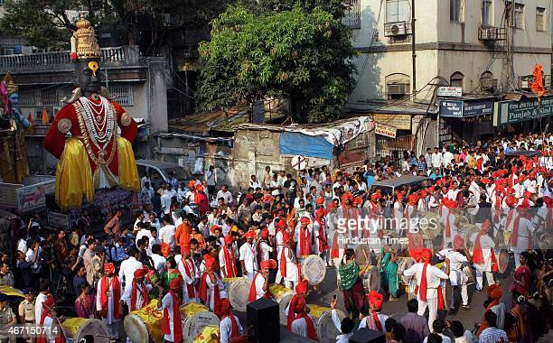 People performing traditional dance on the occasion of Gudi Padwa, Marathi New year at Charni Road on March 21, 2015 in Mumbai, India. Celebrated on...