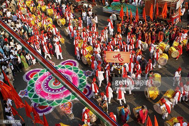 People performing traditional dance on the occasion of Gudi Padwa Marathi New year at Charni Road on March 21 2015 in Mumbai India Celebrated on the...