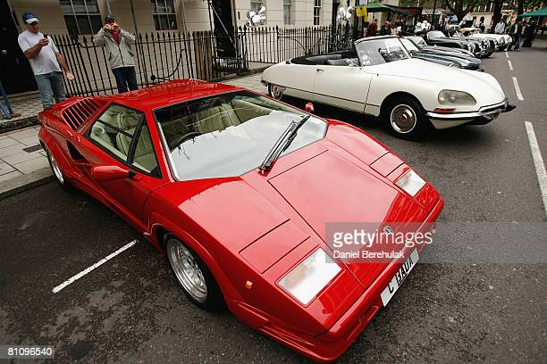 People photograph a Lamborghini during the the classic and ecocar lineup at the Connaught Village Festival on May 15 2008 in central London England...