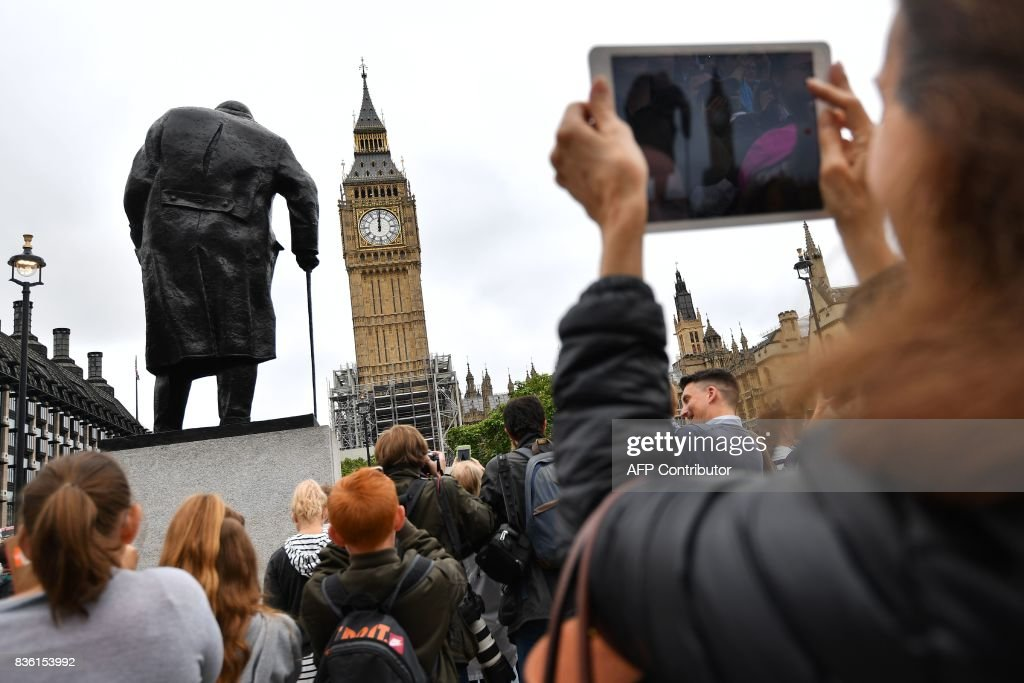 People photograph Elizabeth Tower (Big Ben) in Parliament Square at the Houses of Parliament in London on August 21, 2017 ahead of the final chimes of the famous bell before renovation works begin. Britain's Big Ben bell fell silent on August 21 for four years of renovation work, with its final 12 bongs ringing for midday in front of a crowd of over a thousand people. The repair work on the landmark looming over the Houses of Parliament in Westminster has sparked protests including from Prime Minister Theresa May. STANSALL