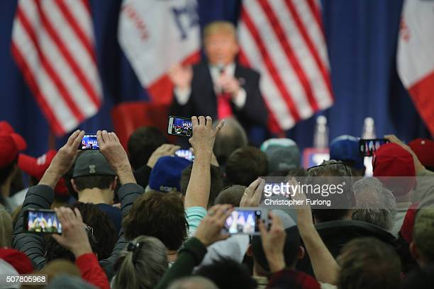 People photograph Republican presidential candidate Donald Trump with their smart phones as he speaks to guests during a campaign rally at the Gerald...