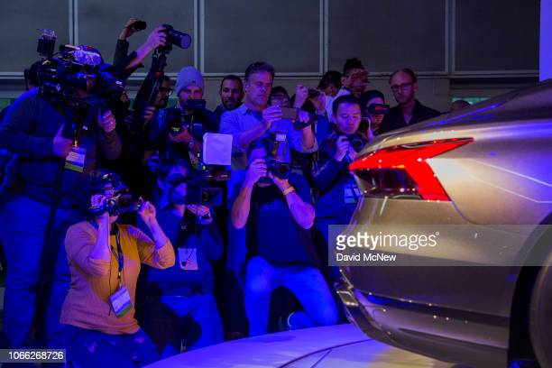 People photograph the Audi etron GT concept during its unveiling at the auto trade show AutoMobility LA at the Los Angeles Convention Center on...