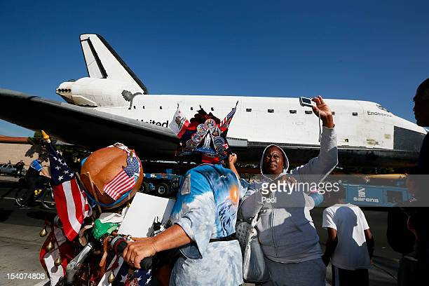 People photograph the Space Shuttle Endeavour as it is moved to the California Science Center on October 13 2012 in Inglewood California The space...
