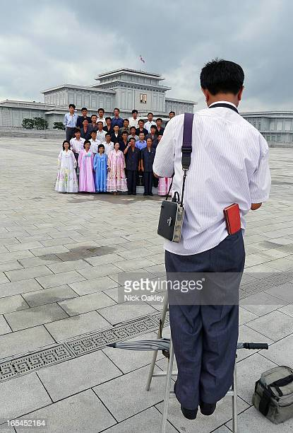 People photographed after pilgrimage to Kim Il Sung mausoleum.