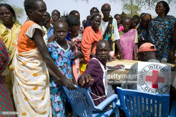 People photographed registering in Abathok village during an International Committee of the Red Cross distribution of seeds agricultural tools and...