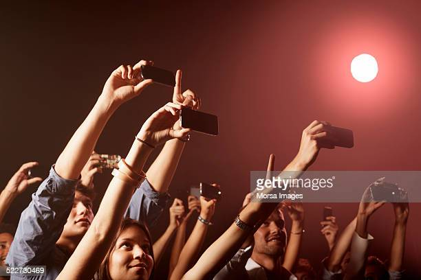People photographing at nightclub