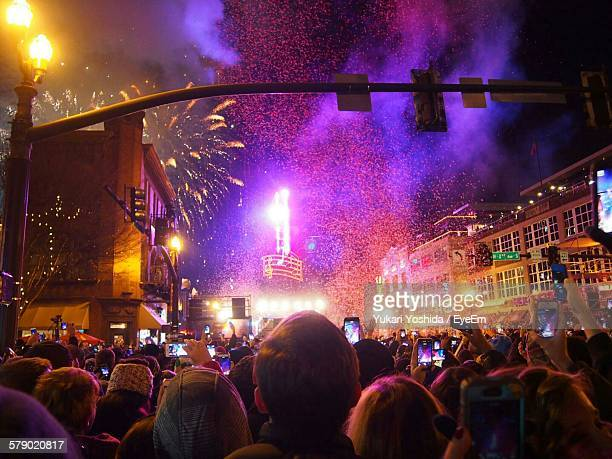 people photographing firework display at night - nashville fotografías e imágenes de stock